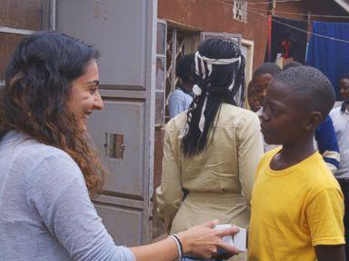 PHOTO: Actress Lupita Nyongo and The Soular Backpack CEO, Salima Visram at a backpack distribution event in Katwe, Uganda.