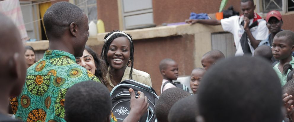 PHOTO: The Soular Backpack CEO, Salima Visram and actress Lupita Nyongo at Soular Backpack distribution event for children in Katwe, Uganda.