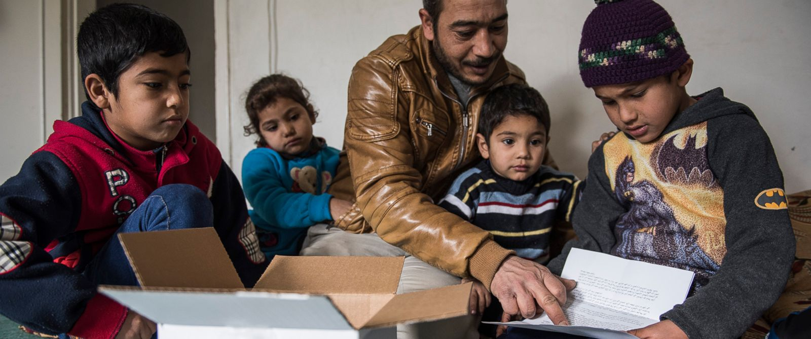 PHOTO: Zaher, at right, is eight years old and lives in an apartment with his family in Irbid, Jordan. His family left Syria after the war broke out and they have received emergency cash assistance from CARE to help them with purchasing food.