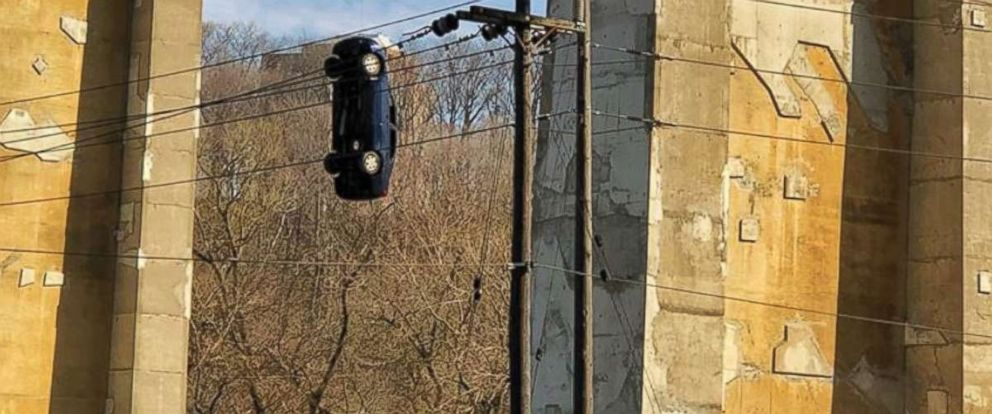 PHOTO: Police in Toronto are investigating a mischievous prank that left a car dangling from a busy bridge.