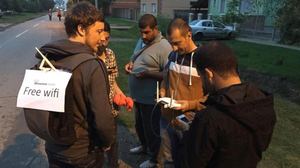 Project Open Network volunteer talking with refugees and migrants in Tovarnik, Croatia, on September 20th.
