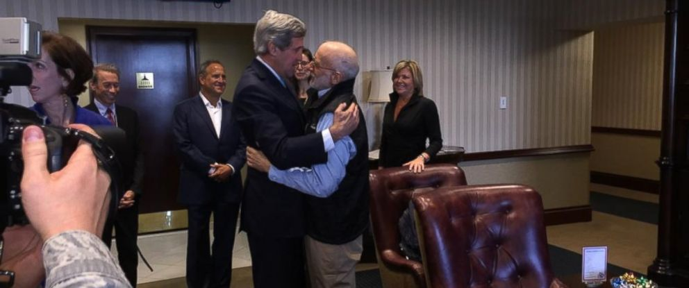 """PHOTO: """"@JohnKerry embraces #AlanGross at Joint Base Andrews,"""" Dec. 17, 2014."""