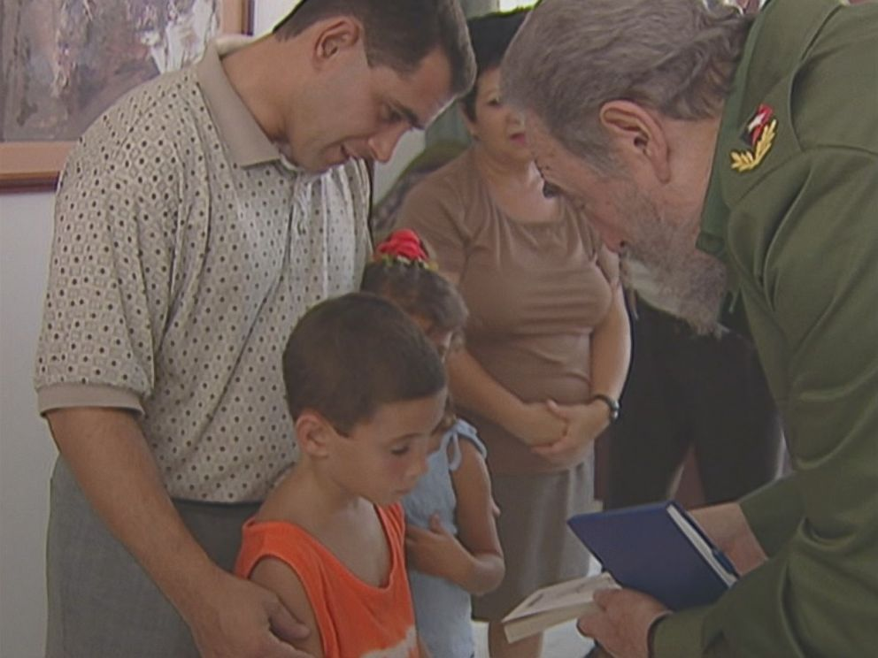 Elian Gonzalez is shown here as a young boy accepting a copy of La Edad de Oro by Jose Marti, given to him and signed by former Cuban president Fidel Castro.