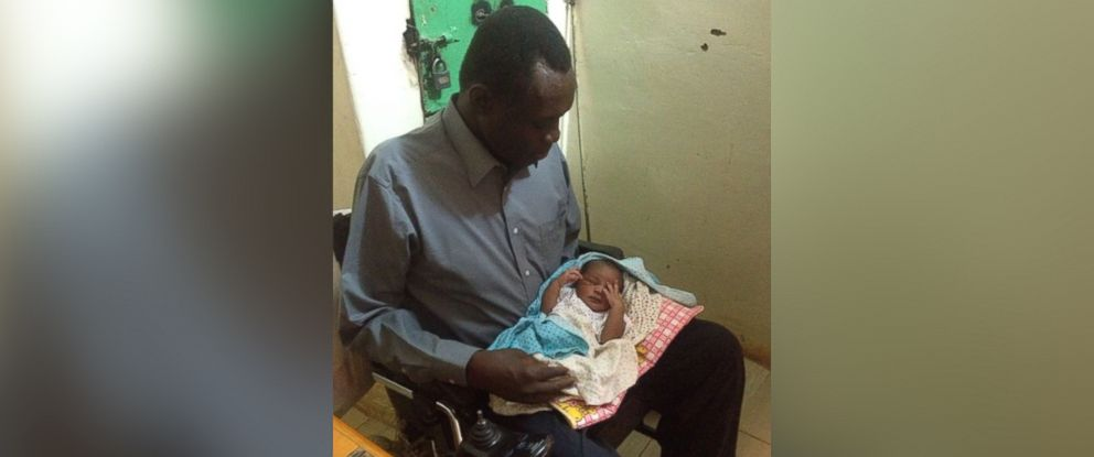 PHOTO: Daniel Wani holds baby Maya for the first time after being allowed to visit to his wife, Meriam Ibrahim, who was sentenced to death for marrying him, a Christian, in Sudan, May 29, 2014.