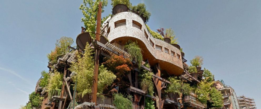 """PHOTO: This pictured apartment building in Turin, Italy, called a """"living forest"""" by its architect Luciano Pia, houses 63 unique apartments and contains terraces with trees and lush gardens."""