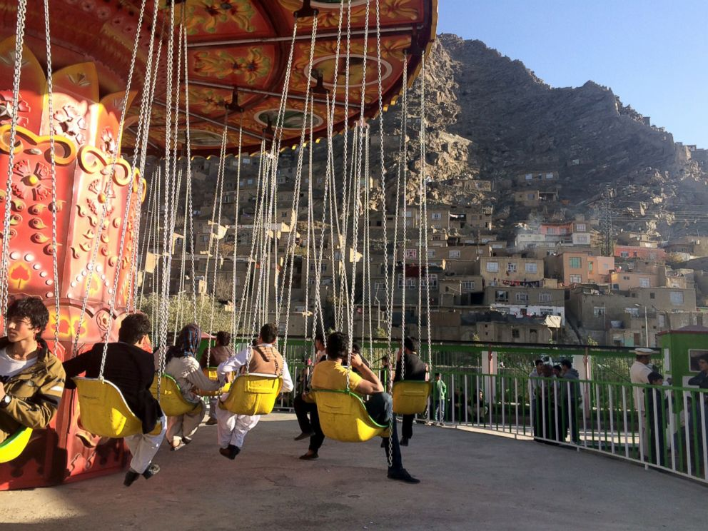 PHOTO: Visitors enjoys rides at City Park, a new amusement park in Kabul.