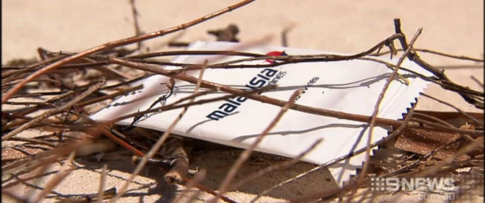PHOTO: A moist towelette with Malaysia Airlines branding on a beach in Western Australia.