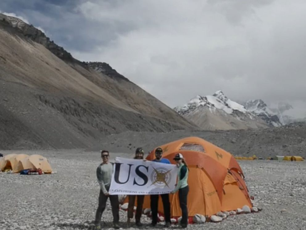 PHOTO: Members of the USX Veteran Everest Expedition hold up a banner at the base camp of Mount Everest.