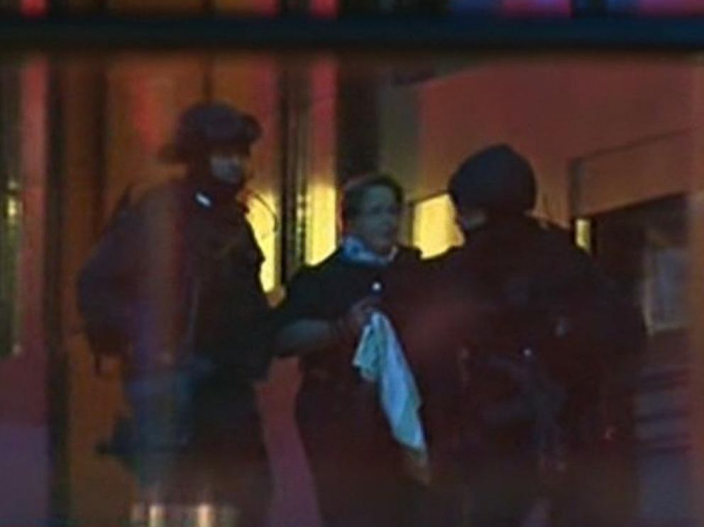 PHOTO: Hostages emerge from a cafe under siege at Martin Place in Sydney, Australia
