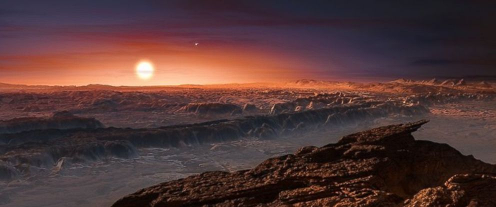 PHOTO: This artists impression shows a view of the surface of the planet Proxima b orbiting the red dwarf star Proxima Centauri, the closest star to the Solar System.