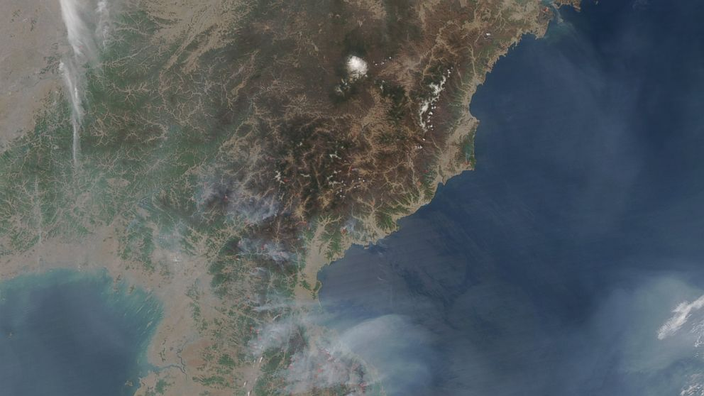 NASA has released satellite images of North Korea, taken on April 25, 2014, showing large fires burning in wooded areas all across the country.