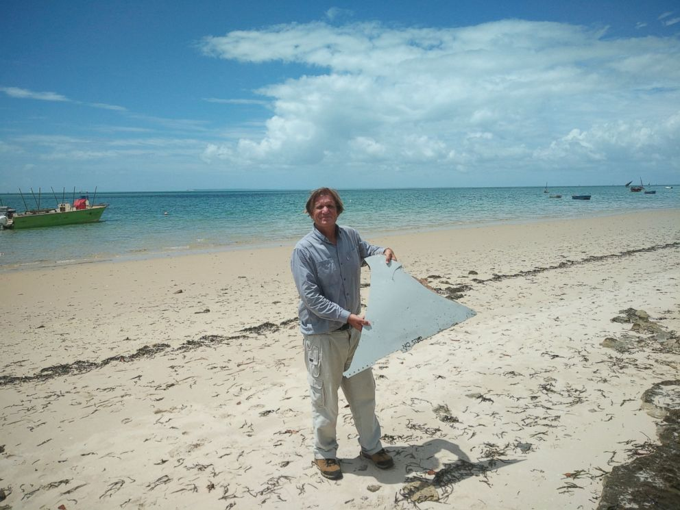 PHOTO: Blaine Alan Gibson holds debris he found on a beach in Mozambique. Officials are investigating if it is from the missing Malaysian Airline flight 370.