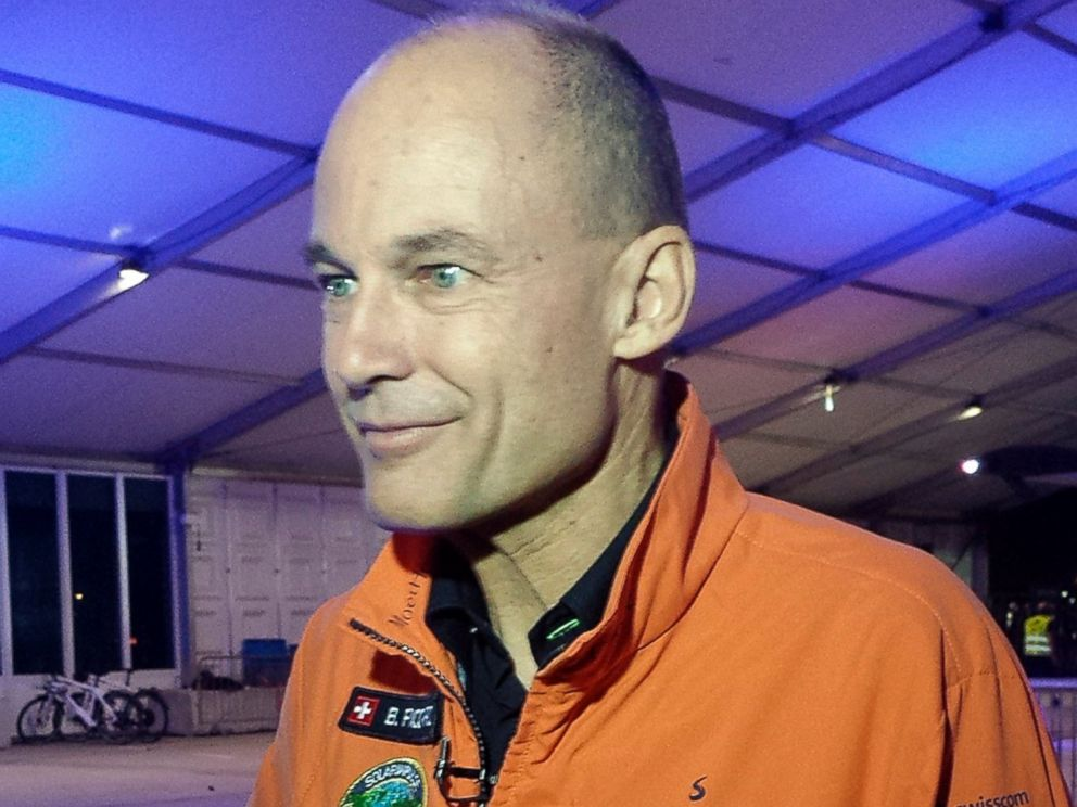 PHOTO: Solar Impulse co-founder and pilot Bertrand Piccard speaks to reporters at an airport