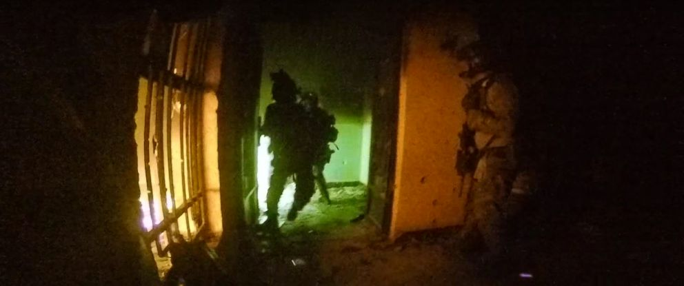 PHOTO: A still from a video shows the raid of an ISIS stronghold in northern Iraq.