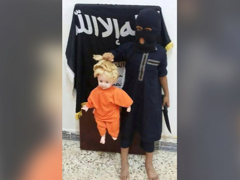 PHOTO: In ISISs Raqqa training camps, children are taught how to cut off the heads of blonde, blue-eyed dolls.