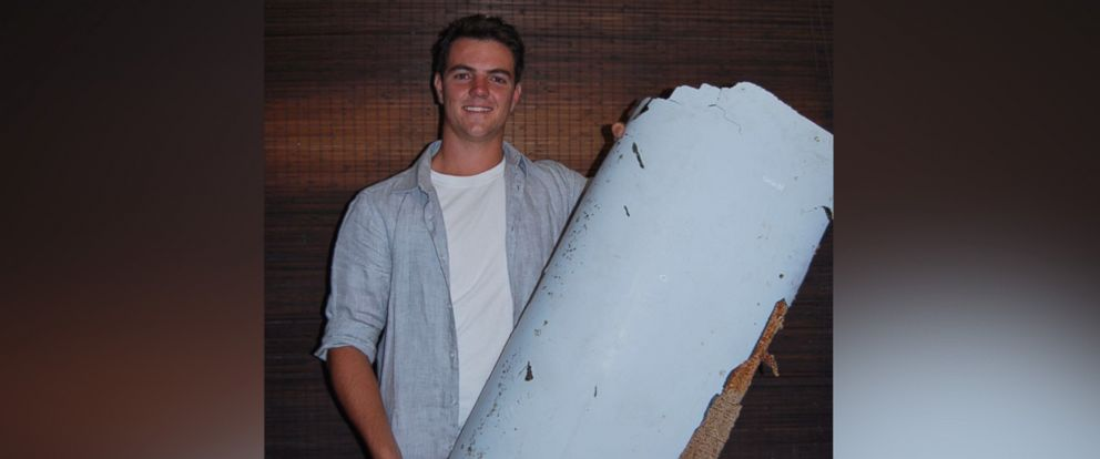 PHOTO: South African teenager Liam Lotter, 18, holding a possible piece of plane debris he found in Mozambique.