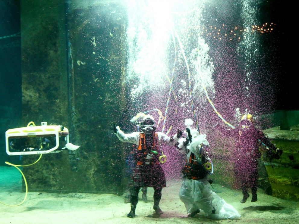 PHOTO: Dorota Bankowska and new husband James Abbott renew their vows underwater inside a diving tank at Fort William Underwater Center in Scotland, Nov. 22, 2014.