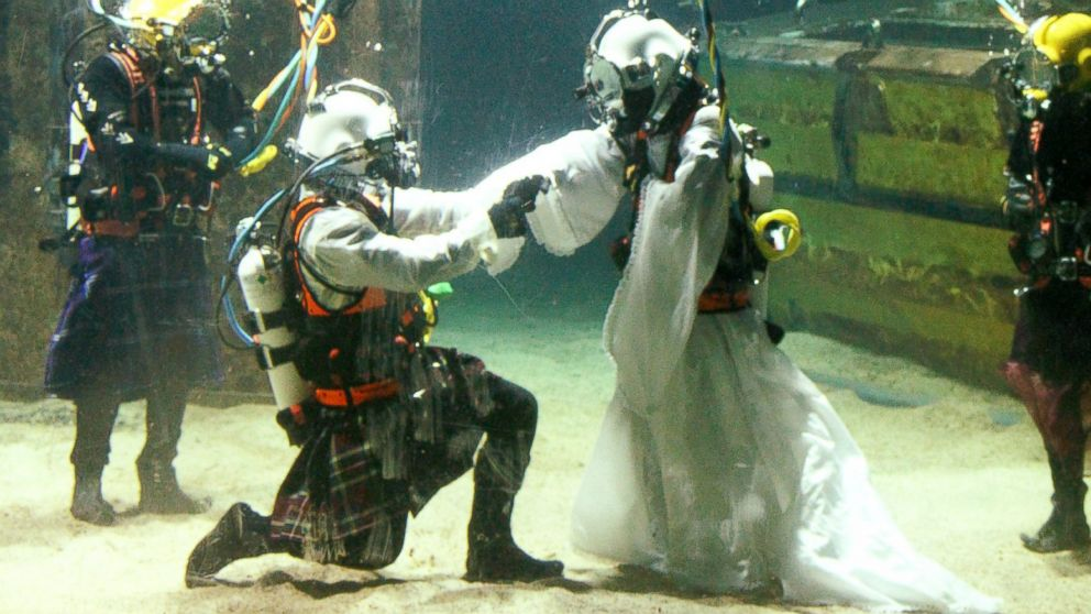 Dorota Bankowska and new husband James Abbott renew their vows underwater inside a diving tank at Fort William Underwater Center in Scotland, Nov. 22, 2014.