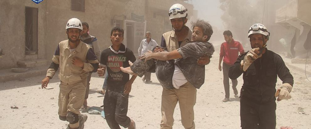 "PHOTO: Members of the Syria Civil Defence or ""White Helmets"" are seen helping a man in this undated file photo."