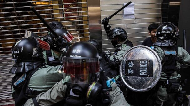 Hong Kong protester shot by police while a pro-China man is set on fire, over 260 arrested
