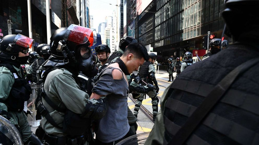 Hong Kong protester shot by police while a pro-China man is set on fire, over 260 arrested - ABC News