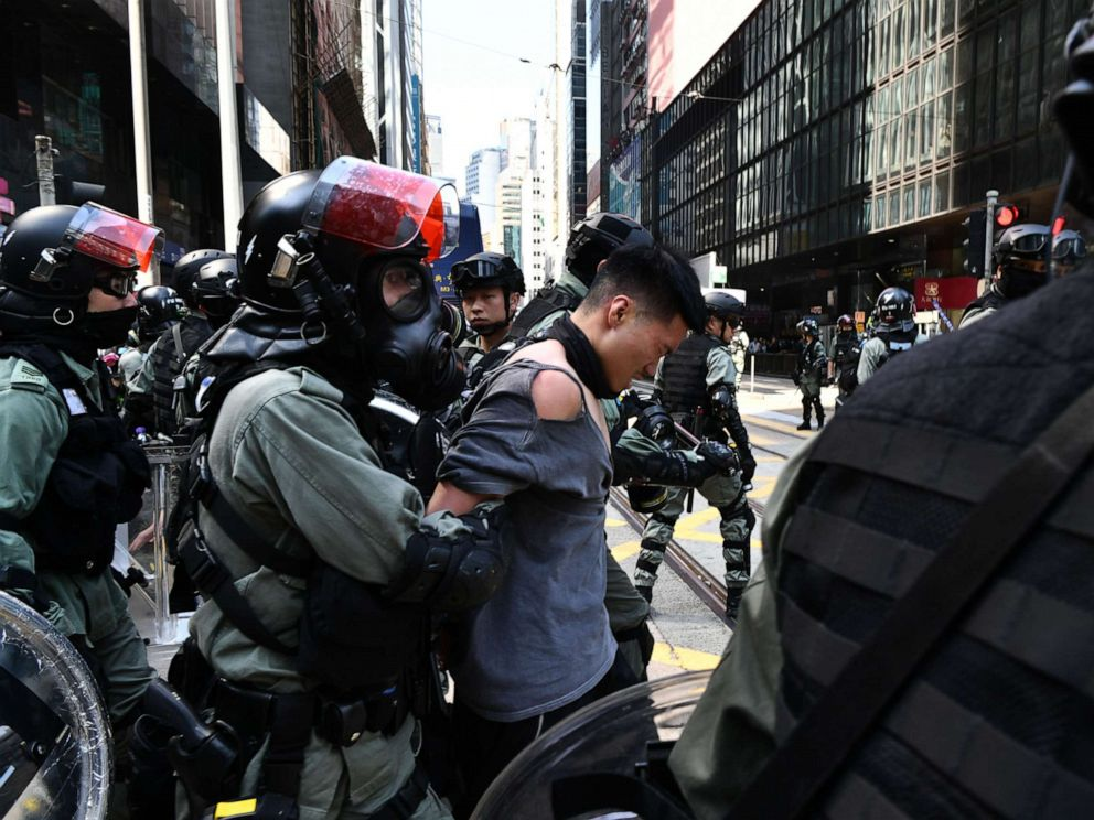 PHOTO: A man (C, in torn shirt) is detained by riot police during a protest in Hong Kongs Central district on November 11, 2019. (Photo by ANTHONY WALLACE/AFP via Getty Images)