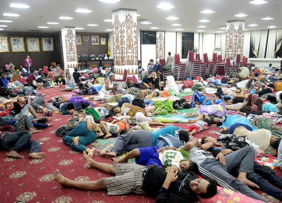 People who lived on the coast of Bandar Lampung rest at a government building after they evacuated following a tsunami in Indonesia, Dec. 24, 2018.