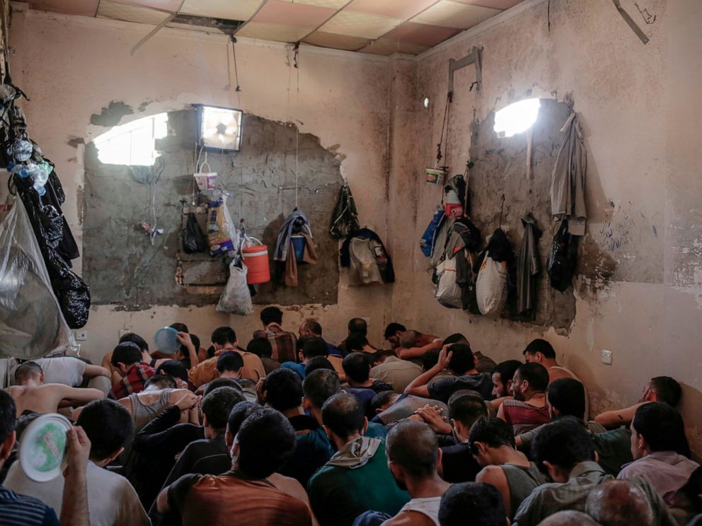 PHOTO: In this Tuesday, July 18, 2017 file photo, Suspected Islamic State members sit inside a small room in a prison south of Mosul, Iraq.
