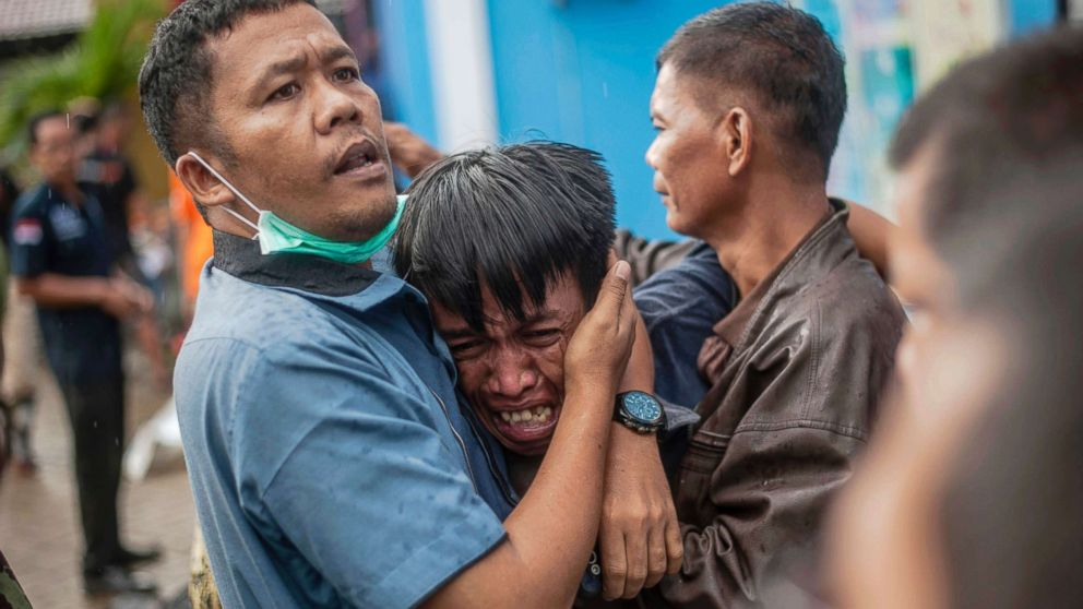 A man reacts after identifying his relative among the bodies of tsunami victims in Carita, Indonesia,  Dec. 23, 2018.