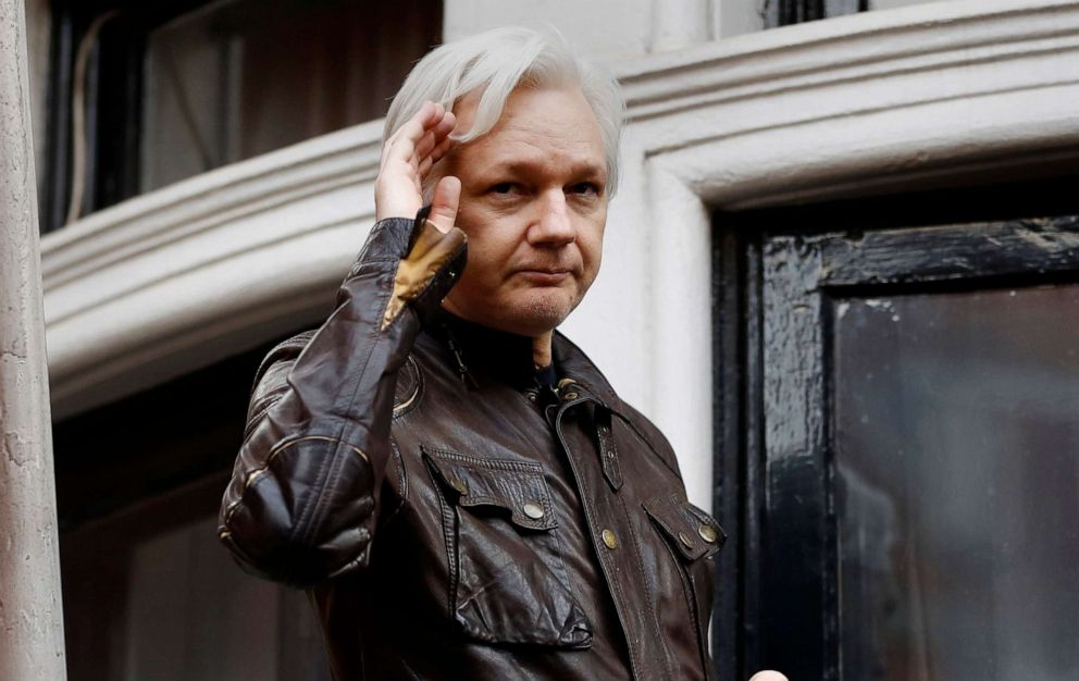 PHOTO: WikiLeaks founder Julian Assange greets supporters from a balcony of the Ecuadorian embassy in London, May 19, 2017.