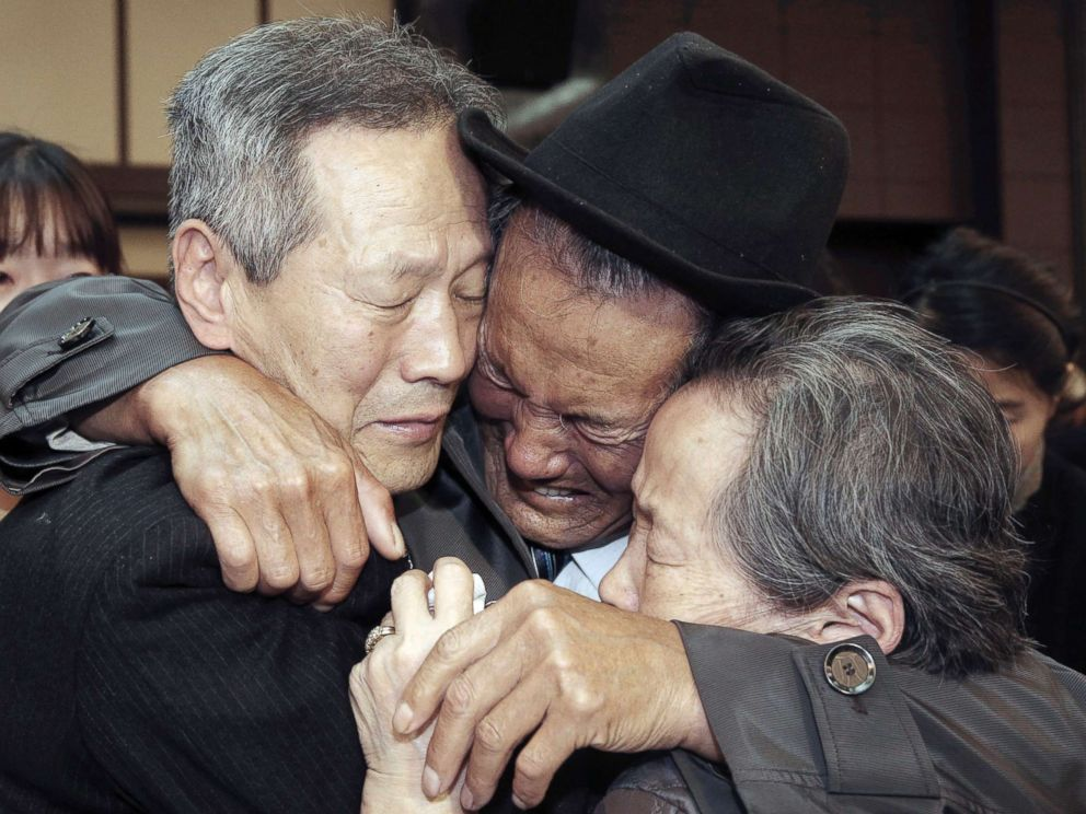 Kwon Geun center weeps with his South Korean relatives as he bids farewell after the Separated Family Reunion Meeting at Diamond Mountain resort in North Korea Oct. 22 2015