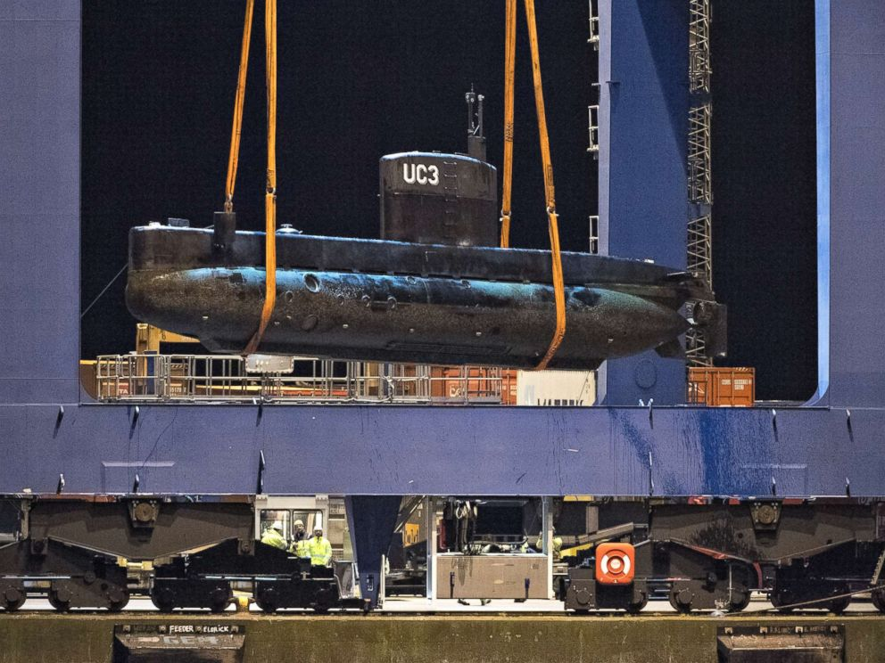 PHOTO: The submarine UC3 Nautilus is lifted onto a block truck from the salvage ship Vina with the help of a container crane in Copenhagens Harbor, Denmark,August 12, 2013.