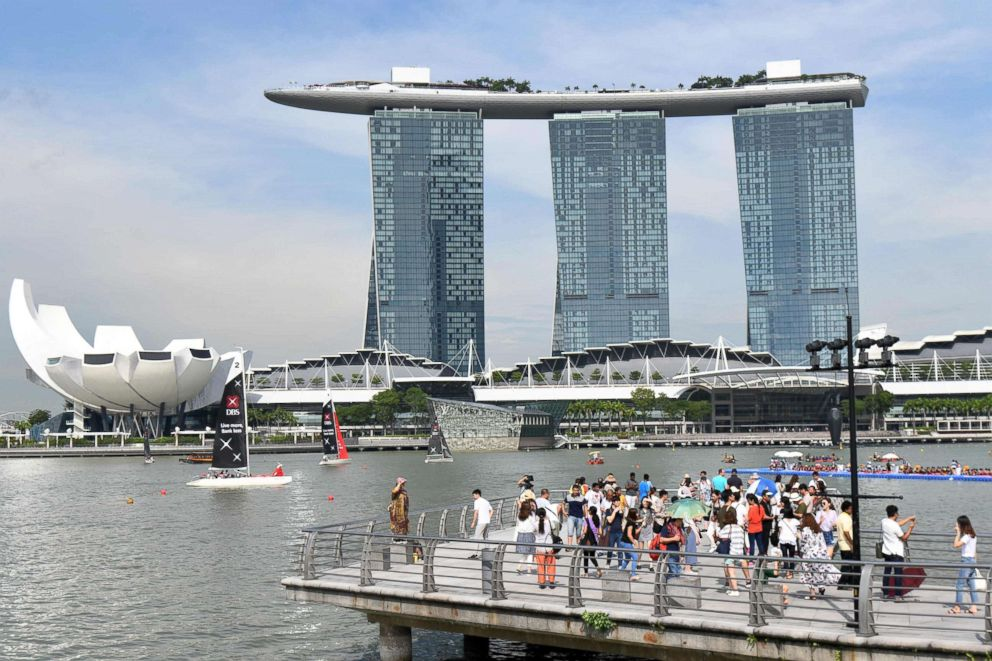 PHOTO: People view the Marina Bay Sands hotel and resort from the Merlion Park on May 27, 2018 in Singapore.