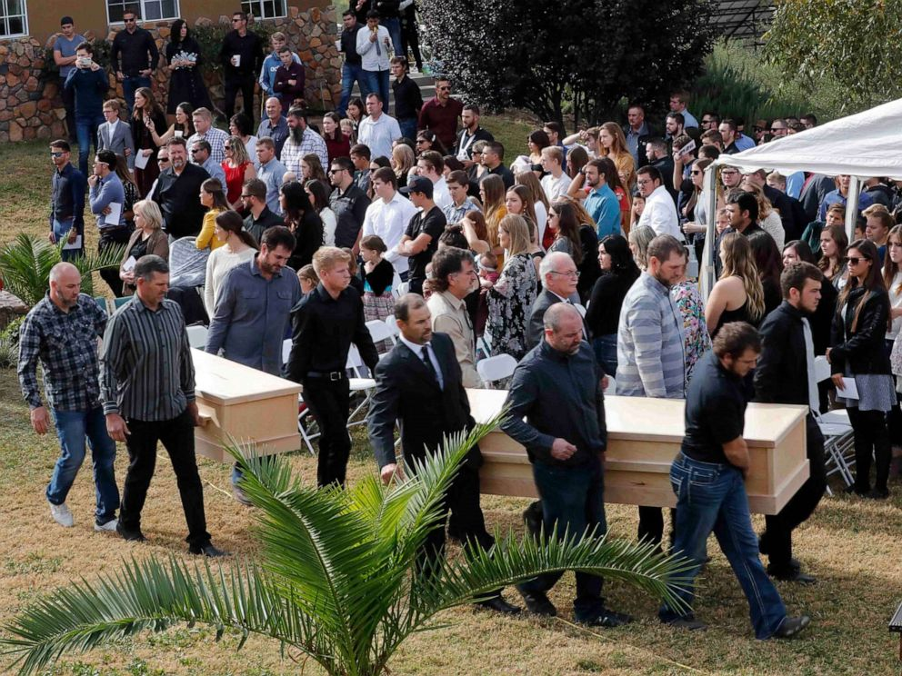 PHOTO: Men carry the caskets of Dawna Ray Langford, 43, and her sons Trevor, 11, and Rogan, 2, who were killed by drug cartel gunmen, during their funeral at the cemetery in La Mora, Sonora state, Mexico, Nov. 7, 2019.