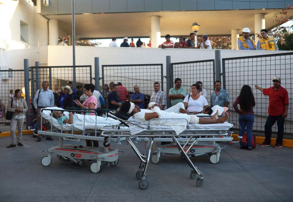 PHOTO: Patients rest in their hospital beds parked outside the General Hospital after they were evacuated, in Veracruz, Mexico, Feb. 16, 2018.