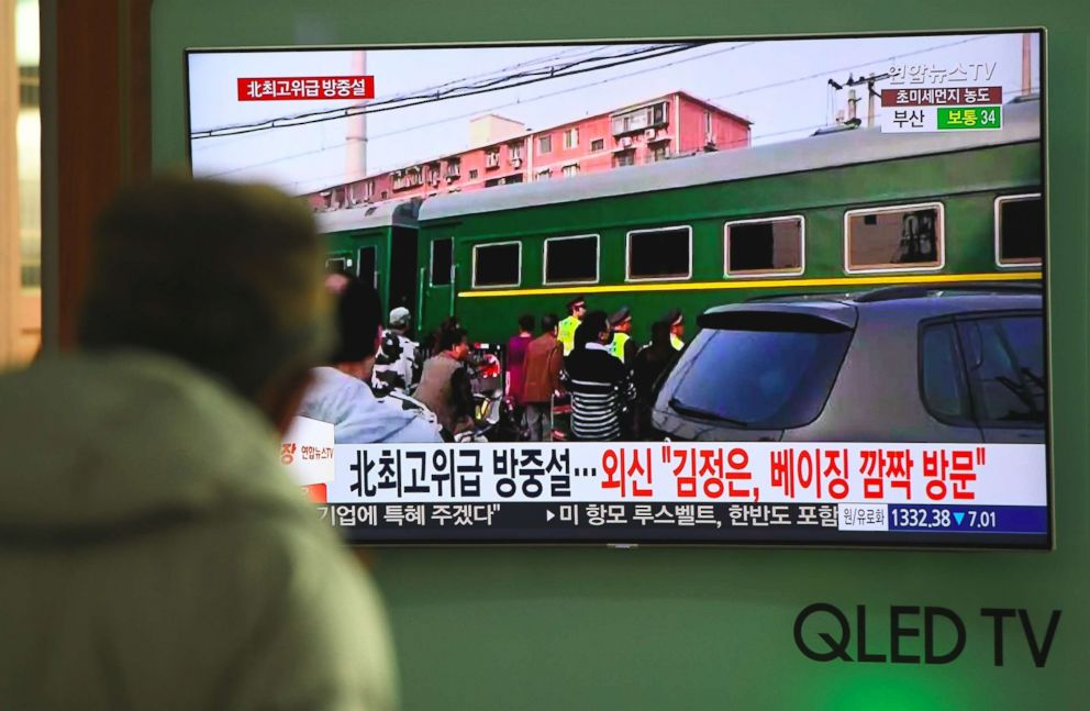 PHOTO: A man watches a television news report about a suspected visit to China by North Korean leader Kim Jong Un, at a railway station in Seoul on March 27, 2018.