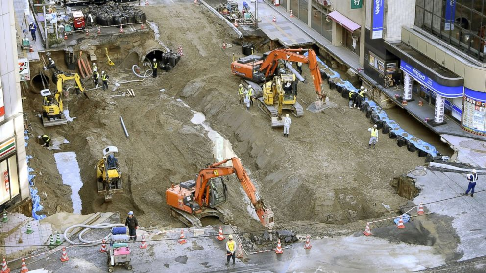 Work continues to fill a huge sinkhole, believed to have been caused by subway construction, beneath a major road near JR Hakata Station in the southwestern Japan city of Fukuoka on Nov. 11, 2016.