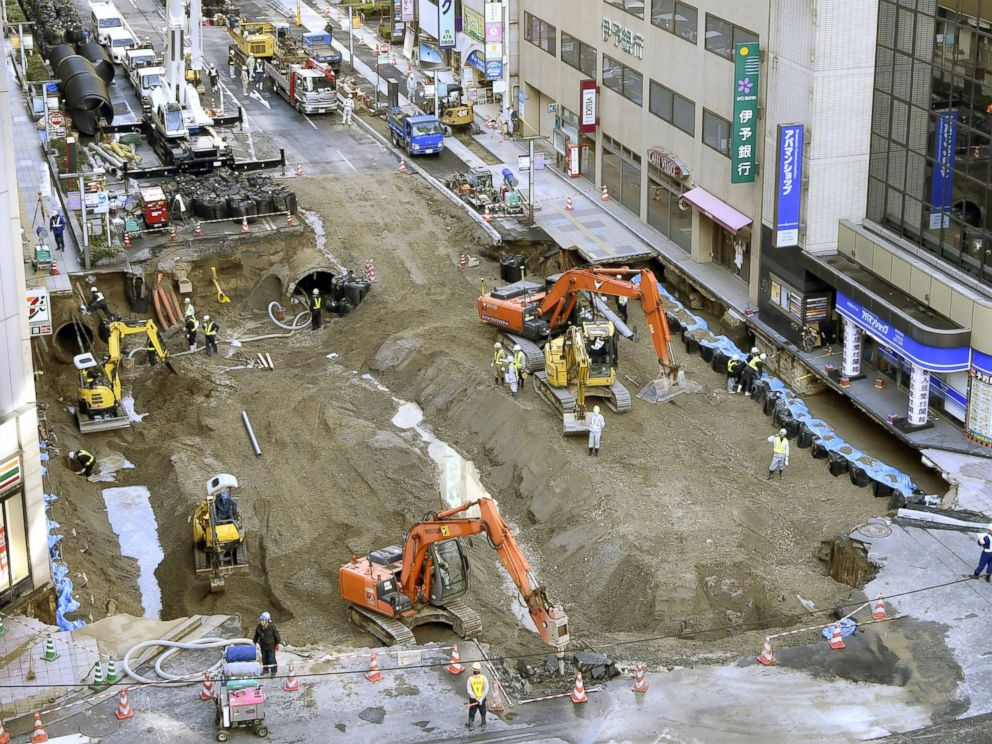 PHOTO: Work continues to fill a huge sinkhole, believed to have been caused by subway construction, beneath a major road near JR Hakata Station in the southwestern Japan city of Fukuoka on Nov. 11, 2016.