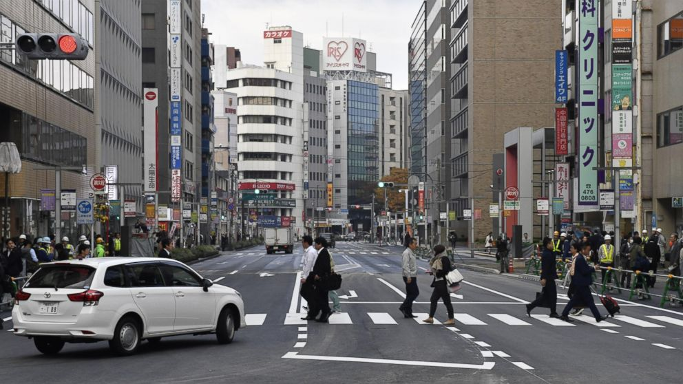 A road in front of JR Hakata station in the southwestern Japan city of Fukuoka reopens on Nov. 15, 2016, after a huge sinkhole there was filled with soil. The sinkhole measured 30-meter-long, 27-meter-wide, 15-meter-deep.