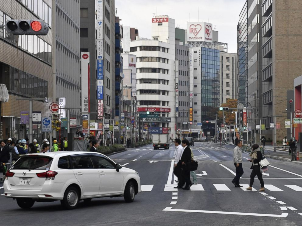 PHOTO: A road in front of JR Hakata station in the southwestern Japan city of Fukuoka reopens on Nov. 15, 2016, after a huge sinkhole there was filled with soil. The sinkhole measured 30-meter-long, 27-meter-wide, 15-meter-deep.
