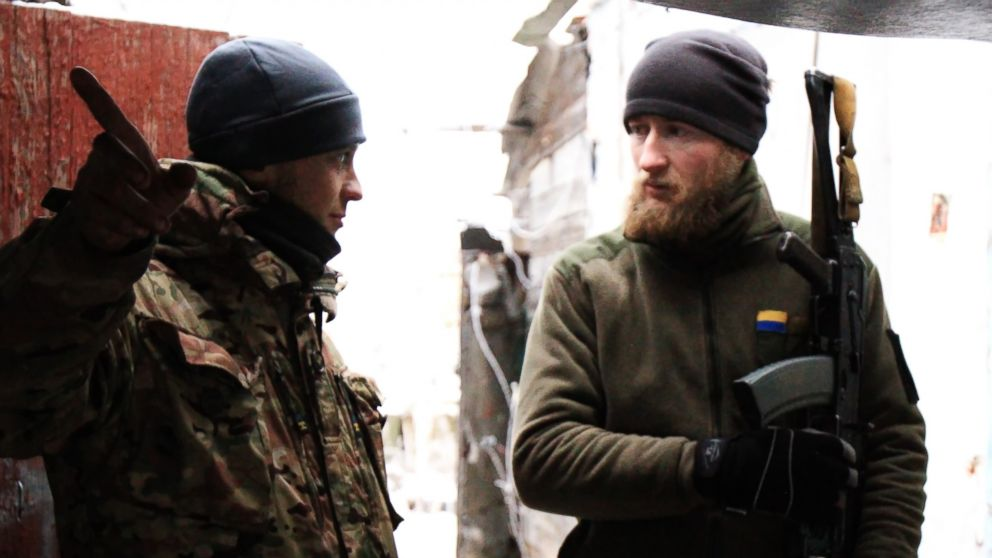 Two Ukrainian soldiers chat in a watch house of Marinka, Donetsk region, Ukraine, Dec. 24, 2016. The Ukrainian government reached a ceasefire with independence-seeking insurgents starting from Dec. 24 as was agreed by the Trilateral Contact Group on Ukraine crisis.