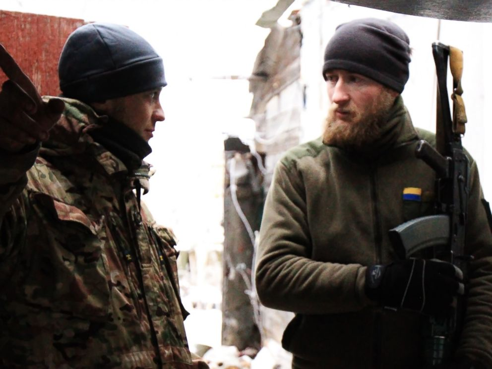PHOTO: Two Ukrainian soldiers chat in a watch house of Marinka, Donetsk region, Ukraine, Dec. 24, 2016.