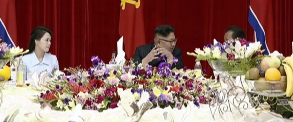 PHOTO: Kim Jong Un speaks with an official during a party in Pyongyang, North Korea, July 10, 2017, to celebrate the successful launch of an intercontinental ballistic missile, in this photo taken from Korean Central Television.