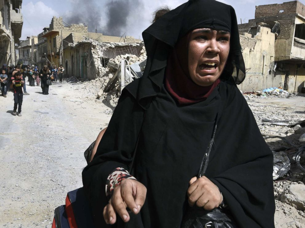 PHOTO:Civilians, many injured and weak, flee continued battle with ISIS in West Mosul amid ruins of the city, July 2, 2017 in Mosul, Iraq.