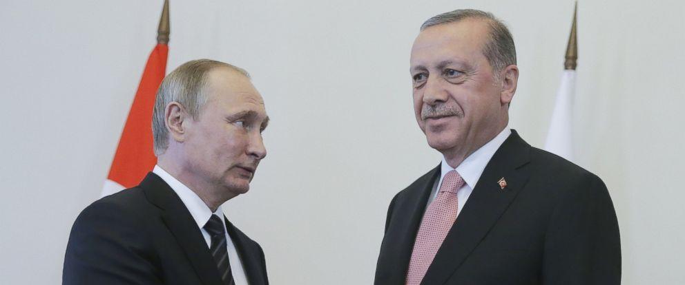 PHOTO: Russias President Vladimir Putin (L) and Turkeys President Recep Tayyip Erdogan shake hands during a meeting in Konstantin Palace, Aug. 9, 2016, in St. Petersburg, Russia.
