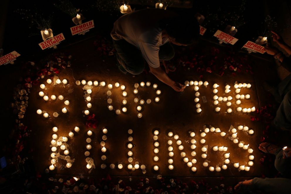 An activist lights candles to denounce the extra-judicial killings against alleged suspects involved in illegal drugs during a protest in Quezon City, Philippines, Aug. 15, 2016.