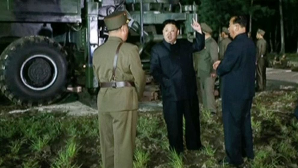 In this image made from video by North Korea's KRT on Friday, July 28, 2017, North Korean leader Kim Jung Un, center, gestures at the site of a missile test at an undisclosed location in North Korea. The clear message after Friday's late-night test, the second in a month of a missile that may be able to reach most of the U.S. mainland.