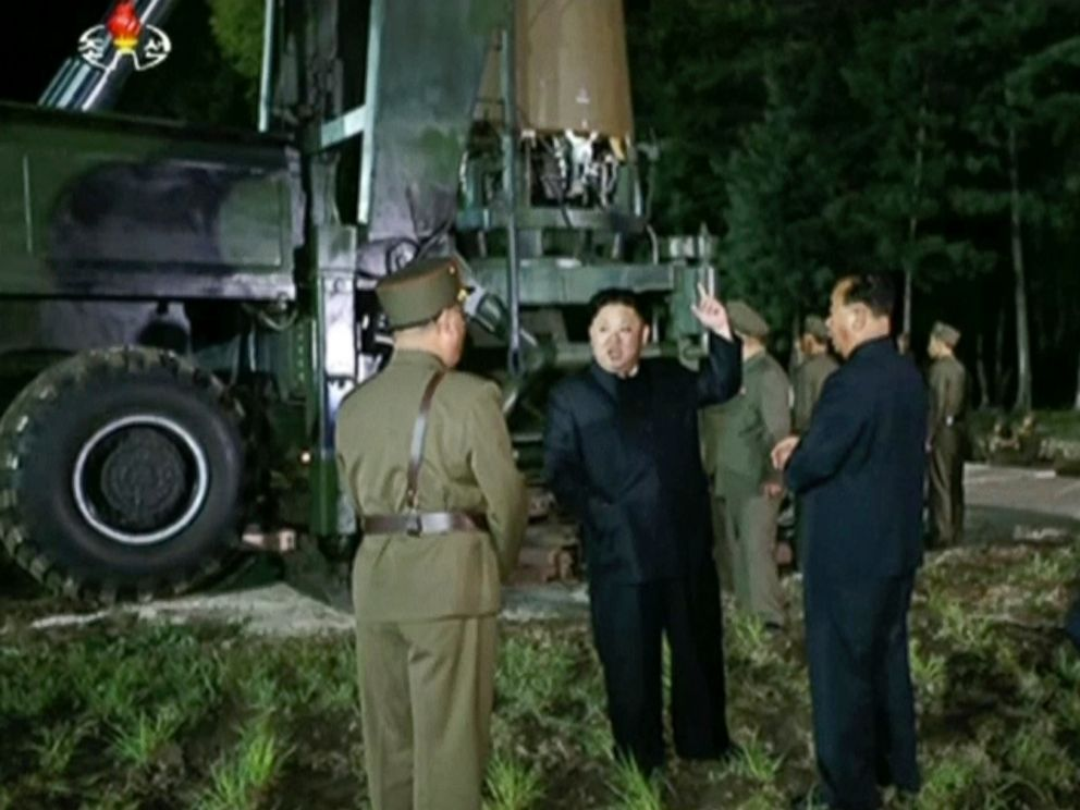PHOTO: In this image made from video by North Koreas KRT on Friday, July 28, 2017, North Korean leader Kim Jung Un, center, gestures at the site of a missile test at an undisclosed location in North Korea.