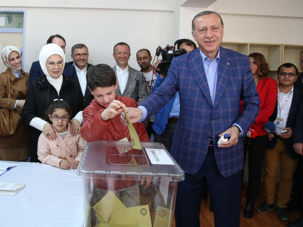 PHOTO: Turkish President Recep Tayyip Erdogan, right, casts his ballot in the countrys referendum to allow for the expansion of executive powers at a polling station, April 16, 2017, in Istanbul.