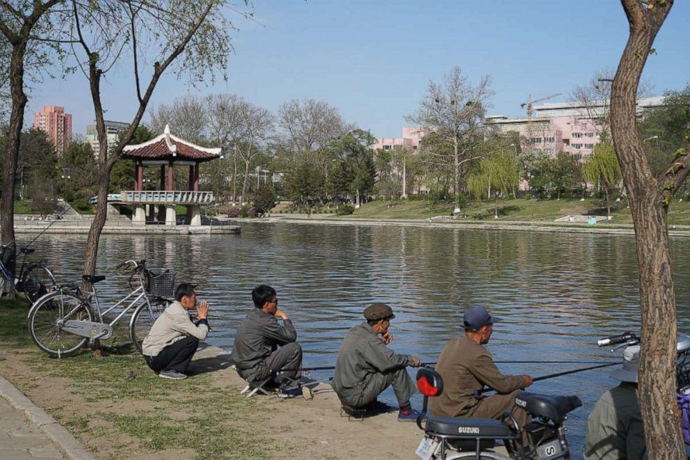 PHOTO: Locals fish in the Potong River, Pyongyang, North Korea, April 21, 2018.